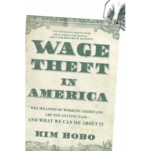 Kim Bobo talks about her new book on Friday night at Women and Children First Bookstore.