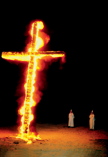 A burning cross is just one of many searing images in Jacob Holdt's American Pictures.