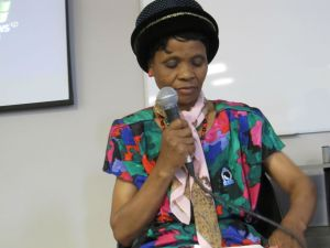 Olga Macingwane prepares to speak at the Engaging the Other Conference.