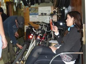 Pumping up tires at Ola Holanda bicycle shop.