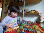 Alejandro shows me dinosaurs in his room and teaches me the Spanish names for them.