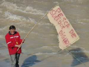 A striking Chilean postal worker fishing for a dignified salary.