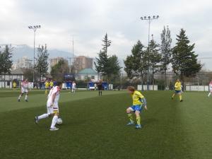 Men playing on the Astroturf soccer field at Estadio Español.