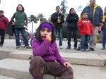 A girl watches the performers at Quinta Normal.