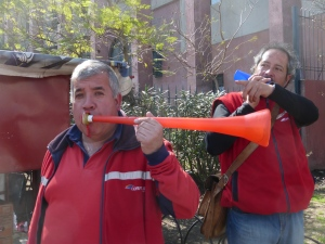 Striking workers blowing horns near Pio Nono.
