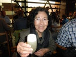 Camila Lopez proudly displays her pisco sour.