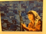 An image of an armed woman at the Salvador Allende Museum.