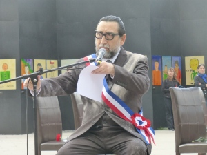 An actor playing Salvador Allende reading his final speech at the Museum of Memory and Human Rights.