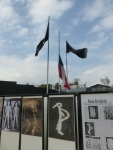 The Chilean flag waves in between two black flags at  at the Museum of Memory and Human Rights.