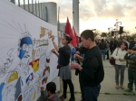 People paint a banner at the Estadio Nacional.