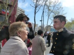 A young naval student who had been leading the group talks with family members on Providencia Ave. on September 19.