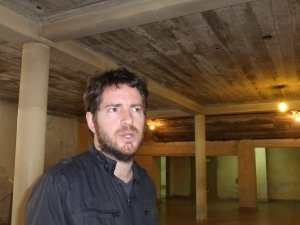 "Emilio stands in the basement that torturers called ""the Avenue of Happiness""."