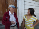Dad and Jenny Manrique talk outside a school in the Palermo neighborhood.