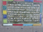 A plaque on the ground dedicated to students who studied at the Nicolas Avellaneda school in Buenos Aires and were disappeared during the Dirty War.